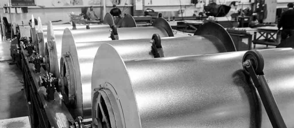 Photo of machines in shop used for rolls of sheet metal