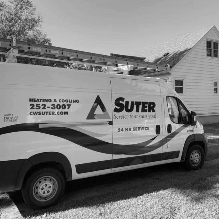 The CW Suter truck is shown in the driveway of a home