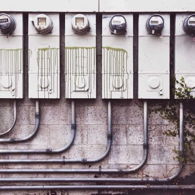 Photo of eight electricity meters mounted to a building's exterior wall